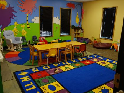 A Dr. Seuss mural adorns the wall of the nursery.