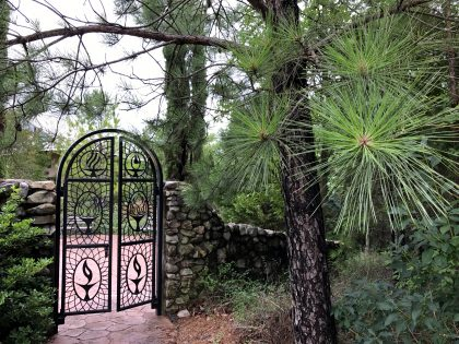 Our grounds are green. Chalices adorn the gate to our memorial garden.