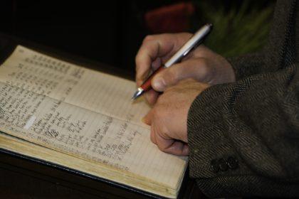 Signing the membership book